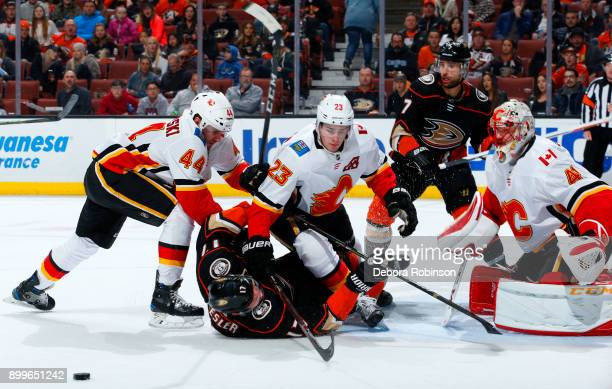 Ryan Kesler and Andrew Cogliano of the Anaheim Ducks battle for the puck against Matt Bartkowski, Sean Monahan, and Mike Smith of the Calgary Flames...