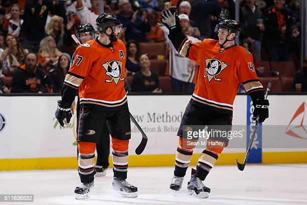 Ryan Kesler and Josh Manson of the Anaheim Ducks react after a goal during the second period of a game against the Calgary Flames at Honda Center on...