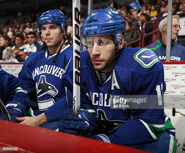 Ryan Kesler and Steve Bernier of the Vancouver Canucks look on from the bench during their game against the Detroit Red Wings at General Motors Place...