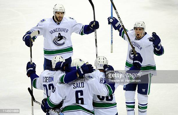 Ryan Kesler Daniel Sedin Sami Salo Henrik Sedin and Alex Burrows of the Vancouver Canucks celebrate Salo's second goal of the second period in Game...