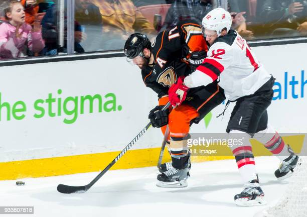 Ryan Kesler of the Anaheim Ducks and Ben Lovejoy of the New Jersey Devils battle for the puck during the second period of the game at Honda Center on...