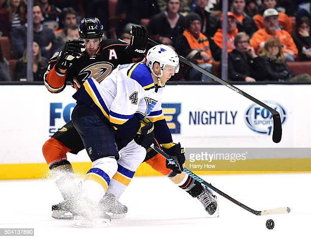 Ryan Kesler of the Anaheim Ducks attempts a move around Carl Gunnarsson of the St Louis Blues during the third period at Honda Center on January 8...