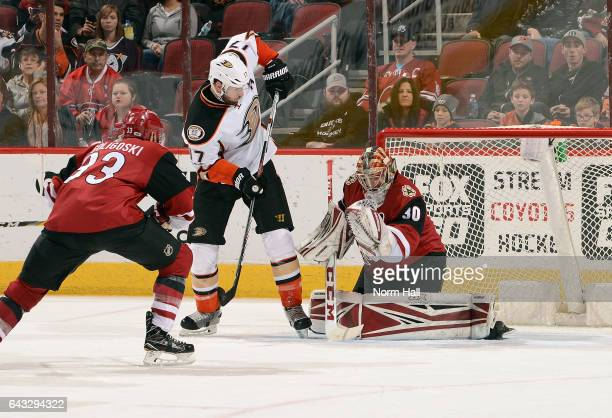 Ryan Kesler of the Anaheim Ducks attempts to redirect the puck past goalie Marek Langhamer of the Arizona Coyotes as AlexGoligoski of the Coyotes...