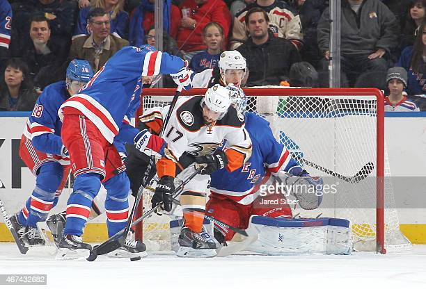 Ryan Kesler of the Anaheim Ducks battles for the puck in front of the net against Dominic Moore and Marc Staal of the New York Rangers at Madison...