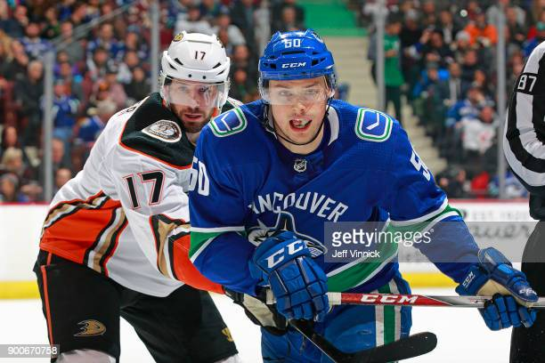 Ryan Kesler of the Anaheim Ducks checks Brendan Gaunce of the Vancouver Canucks during their NHL game at Rogers Arena January 2 2018 in Vancouver...