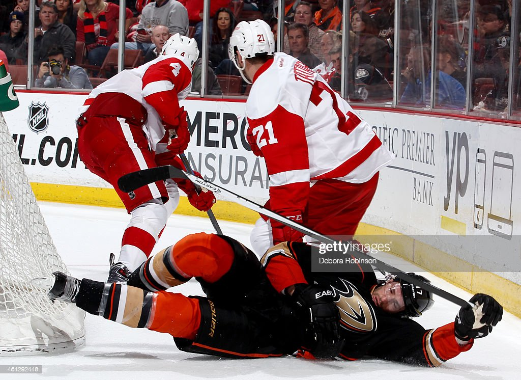 Ryan Kesler #17 of the Anaheim Ducks falls to the ice during the game against the Detroit Red Wings on February 23, 2015 at Honda Center in Anaheim, California.