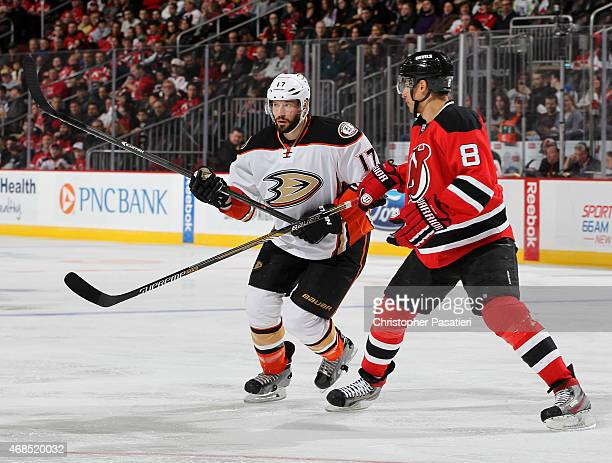 Ryan Kesler of the Anaheim Ducks skates against Dainius Zubrus of the New Jersey Devils during the third period at the Prudential Center on March 29...