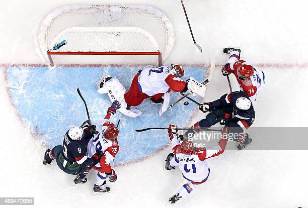 Ryan Kesler of the United States handles the puck against goalkeeper Sergei Bobrovski of Russia as Nikolai Kulyomin and Alexei Yemelin of Russia...