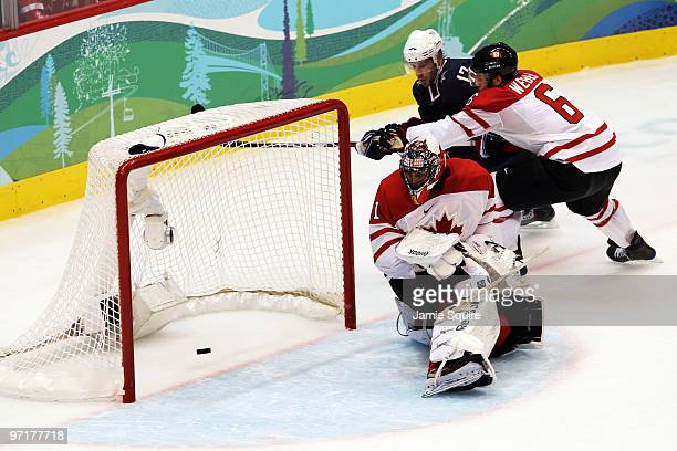 Ryan Kesler of the United States scores a goal on the deflection past Roberto Luongo and Shea Weber of Canada during the ice hockey men's gold medal...