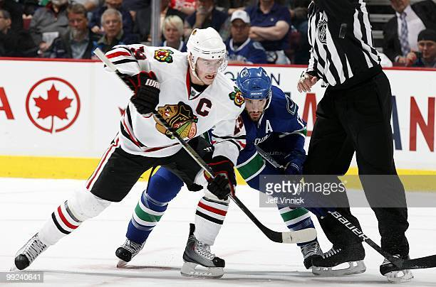 Ryan Kesler of the Vancouver Canucks and Jonathan Toews of the Chicago Blackhawks battle after a face-off in Game 6 of the Western Conference...