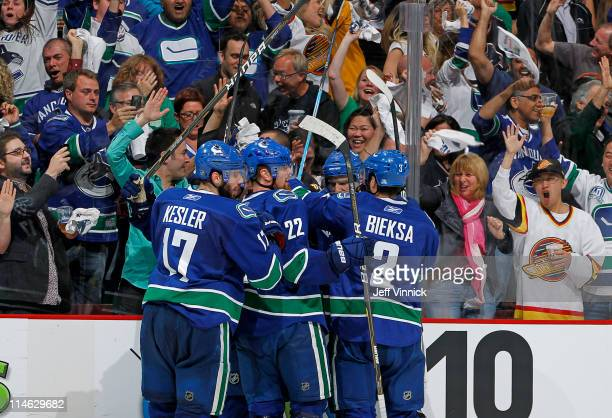Ryan Kesler of the Vancouver Canucks celebrates with teammates after scoring the tying goal in the third period in Game Five of the Western...
