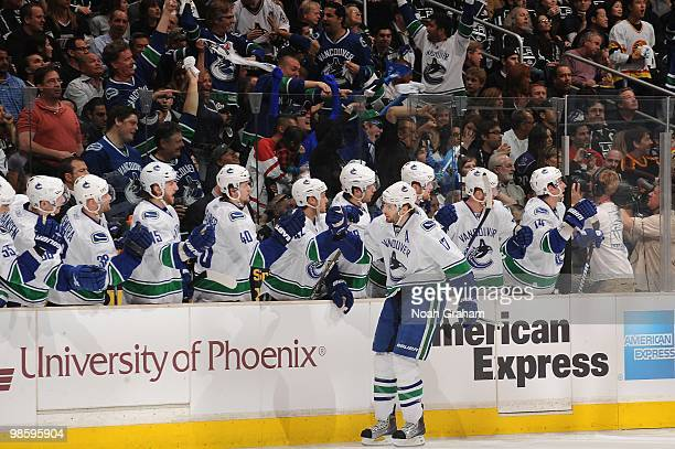 Ryan Kesler of the Vancouver Canucks celebrates with the bench after a goal against the Los Angeles Kings in Game Three of the Western Conference...