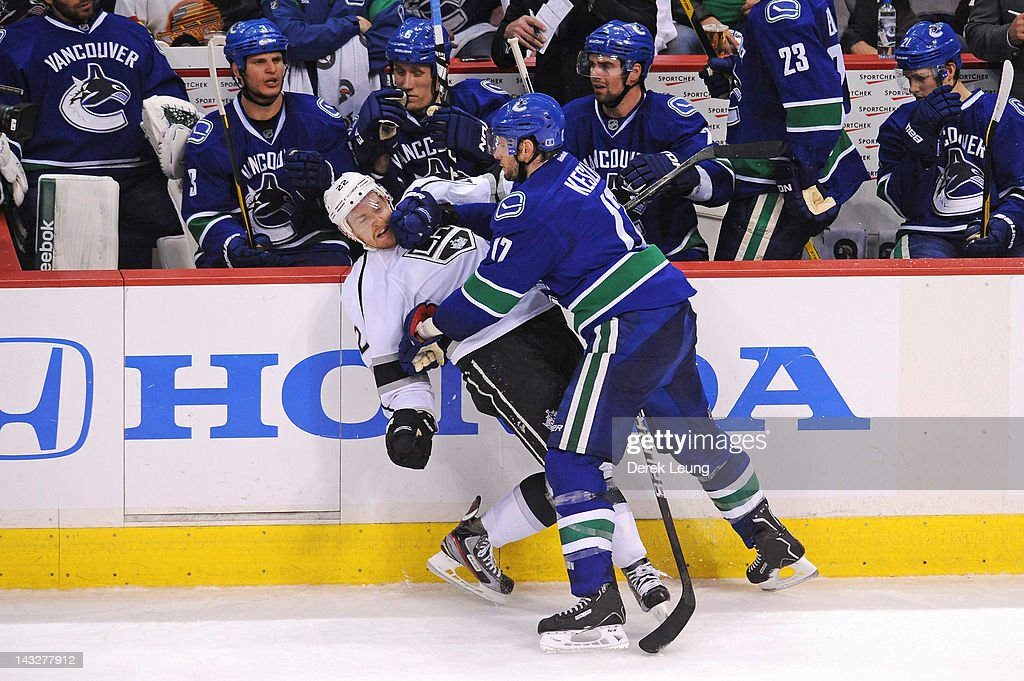 Ryan Kesler #17 of the Vancouver Canucks checks Trevor Lewis #22 of the Los Angeles Kings in Game Five of the Western Conference Quarterfinals during the 2012 NHL Stanley Cup Playoffs at Rogers Arena on April, 22, 2012 in Vancouver, British Columbia, Canada.