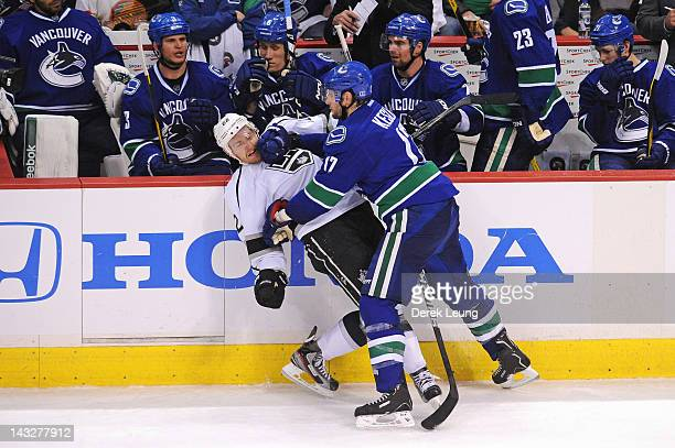 Ryan Kesler of the Vancouver Canucks checks Trevor Lewis of the Los Angeles Kings in Game Five of the Western Conference Quarterfinals during the...