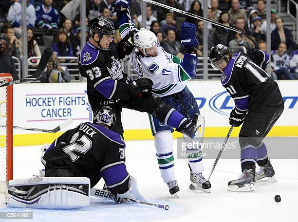 Ryan Kesler of the Vancouver Canucks goes after a rebound in front of Willie Mitchell Anze Kopitar and Jonathan Quick of the Los Angeles Kings at the...