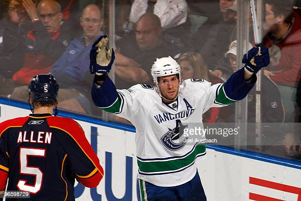 Ryan Kesler of the Vancouver Canucks raises his stick to celebrate after scoring a goal against the Florida Panthers on February 11, 2010 at the...
