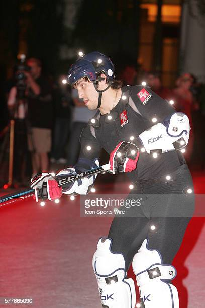 Ryan Kesler of the Vancouver Canucks skates around on a synthetic ice surface set up in front of Caesars Palace Hotel and Casino in Las Vegas NV for...