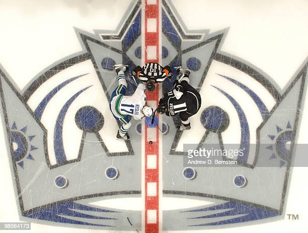 Ryan Kesler of the Vancouver Canucks takes the opening faceoff against Anze Kopitar of the Los Angeles Kings in Game Three of the Western Conference...