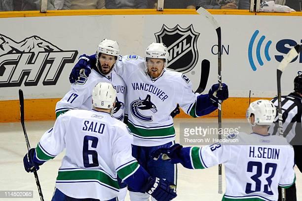 Ryan Kesler Sami Salo Daniel Sedin and Henrik Sedin of the Vancouver Canucks celebrate Kesler's second period goal in Game Four of the Western...