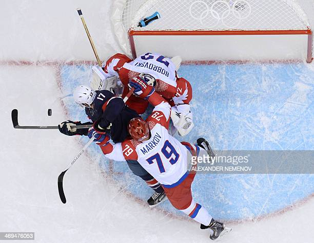 US Ryan Kesler vies with Russia's goalkeeper Sergei Bobrovski during the Men's Ice Hockey Group A match USA vs Russia at the Bolshoy Ice Dome during...