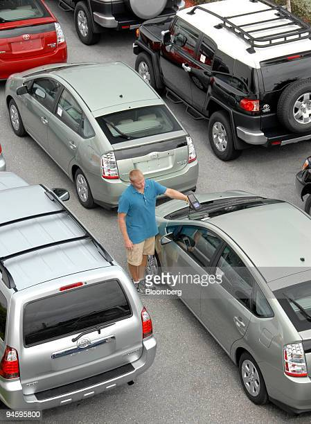 Ryan Kies lot manager for Earl Stewart Toyota in North Palm Beach Floriday scans an inventory sticker on a newly arrived 2007 Toyota Prius Tuesday...