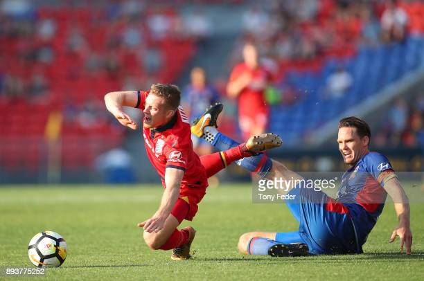 Ryan Kitto of Adelaide and Nigel Boogaard of the Jets contest the ball during the round 11 ALeague match between the Newcastle Jets and the Adelaide...