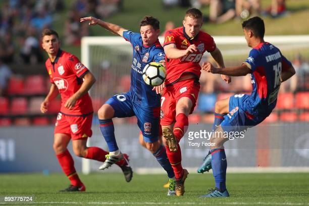 Ryan Kitto of Adelaide and Wayne Brown of the Jets contest the ball during the round 11 ALeague match between the Newcastle Jets and the Adelaide...