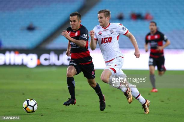 Ryan Kitto of Adelaide is challenged by Steven Lustica of the Wanderers during the round 15 ALeague match between the Western Sydney Wanderers and...