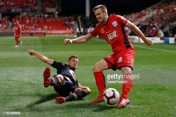 Ryan Kitto of Adelaide United and Oriol Riera of the Wanderers contest the ball during the round 19 A-League match between Adelaide United and the...