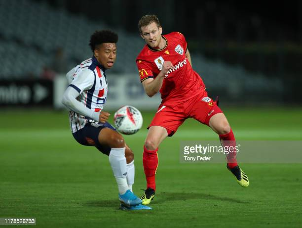 Ryan Kitto of Adelaide United contests the ball with Samuel Silvera of the Central Coast Mariners during the FFA Cup 2019 Semi Final between the...