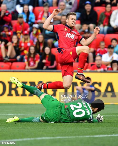 Ryan Kitto of Adelaide United kicks for goal saved by Vedran Janjetovic of West Sydney Wanderers during the round eight ALeague match between...