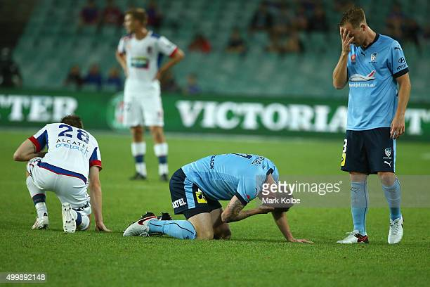 Ryan Kitto of the Jets and Seb Ryall and Rhyan Grant of Sydney FC are seen after a heavy clash during the round nine ALeague match between Sydney FC...