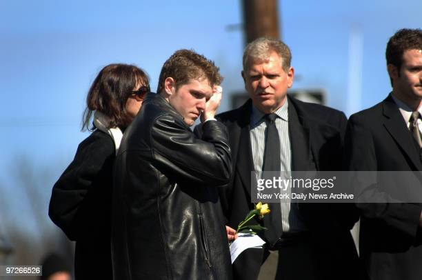 Ryan Kocher the exboyfriend of Imette St Guillen wipes away tears after attending a funeral service for the slain 24yearold graduate student at the...
