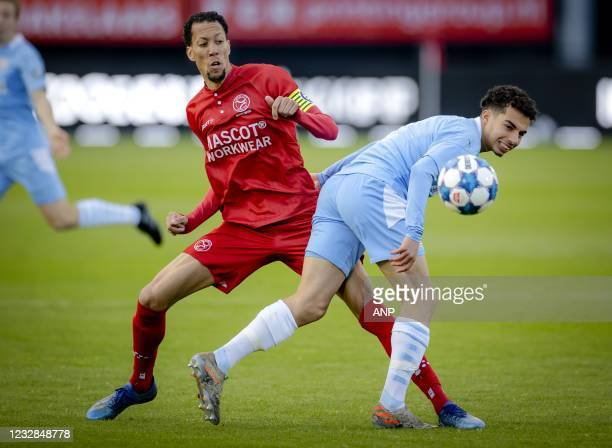 Ryan Koolwijk of Almere City, Manu Matuta or PSV U23 during the Dutch Kitchen champion division match between Almere City and Jong PSV at the Yanmar...