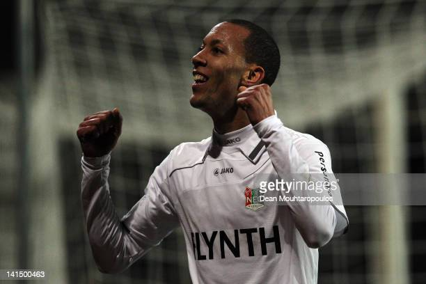 Ryan Koolwijk of NEC celebrates in front of the fans after setting up Leroy George for the first goal of the game during the Eredivisie match between...
