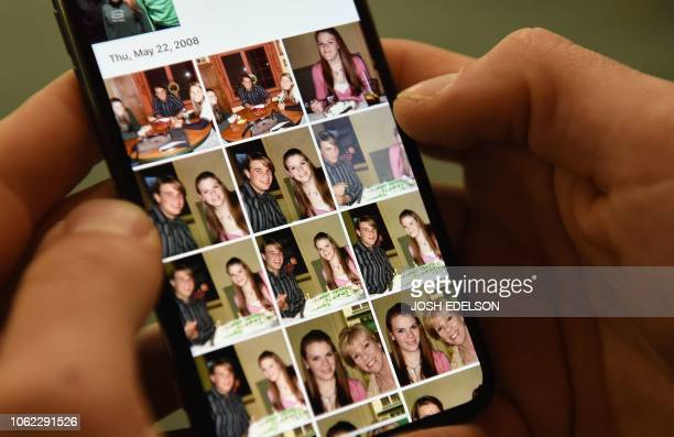 Ryan Kramer who cofounded the Donor Sibling Registry with his mother shows photos of his biological half siblings on his phone at his office in South...