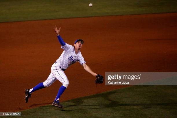 Ryan Kreidler of UCLA tries to get under a fly ball but misses during a baseball game against Long Beach State at Jackie Robinson Stadium on May 07...