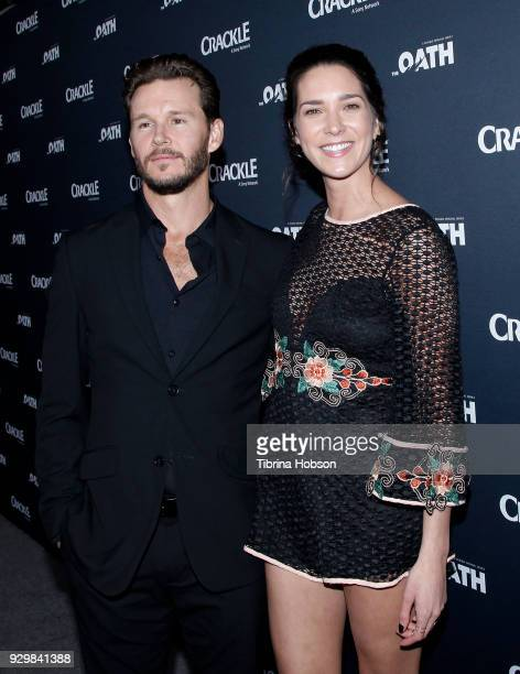Ryan Kwanten and Ashley Sisino attend the premiere of Crackle's 'The Oath' at Sony Pictures Studios on March 7 2018 in Culver City California