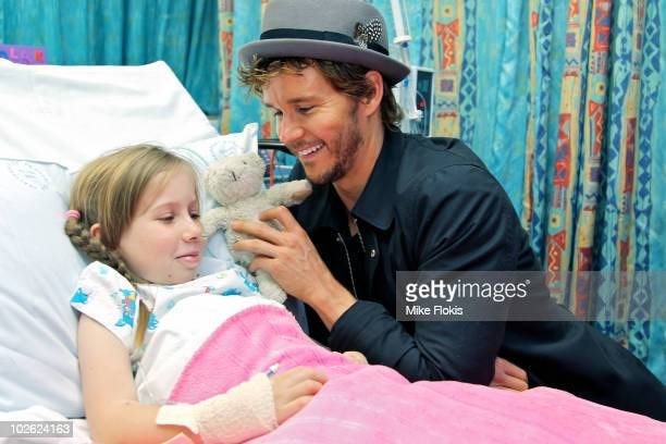 Ryan Kwanten poses for a photo during a visit to deliver the first Telstra TBox to Ronald McDonald House in Randwick on July 5 2010 in Sydney...