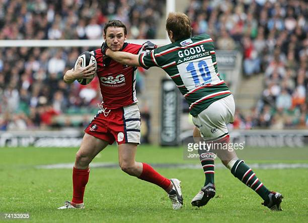 Ryan Lamb of Gloucester is tackled by Andy Goode of Leicester during the Guinness Premiership final between Gloucester and Leicester Tigers at...