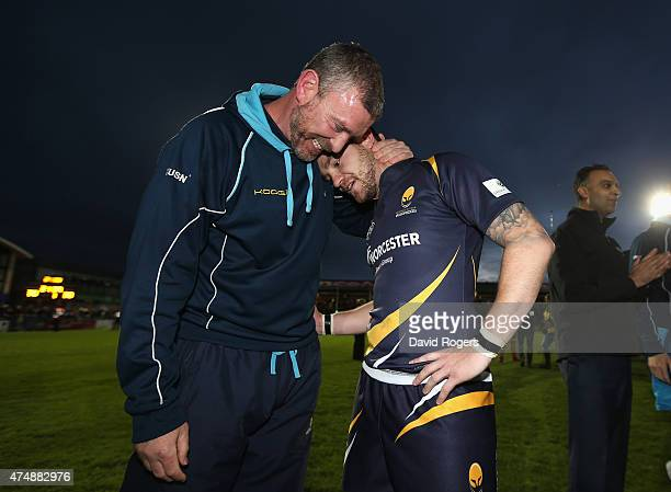 Ryan Lamb of Worcester, who converted the final try to win the match, celebrates with Worcester director of rugby Dean Ryan during the Greene King...