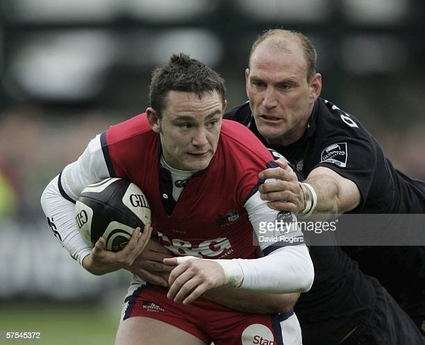 Ryan Lamb, the Gloucester standoff, is held by Lawrence Dallaglio during the Guinness Premiership match between Gloucester and London Wasps at...