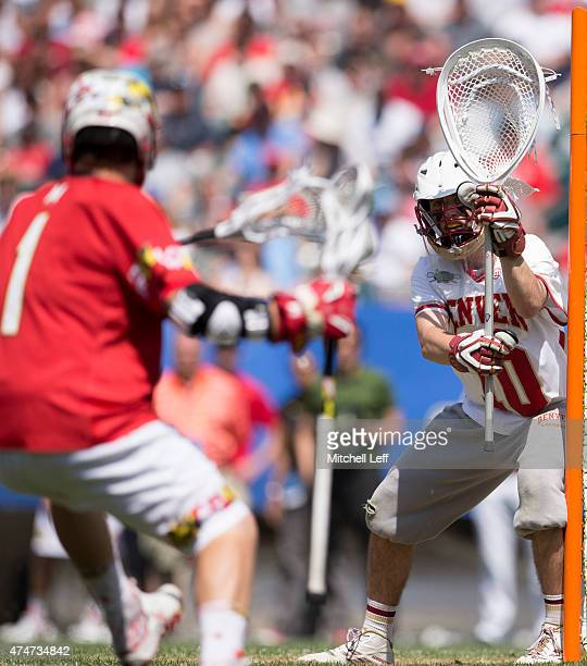 Ryan LaPlante of the Denver Pioneers protects the net against Matt Rambo of Maryland Terrapins on May 25 2015 in the NCAA Division I Men's Lacrosse...
