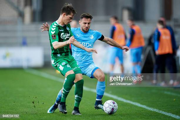 Ryan Laursen of OB Odense and Bashkim Kadrii of Randers FC compete for the ball during the Danish Alka Superliga match between Randers FC and OB...