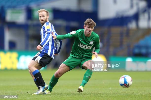 Ryan Ledson of Preston North End battles for possession with Barry Bannan of Sheffield Wednesday during the Sky Bet Championship match between...