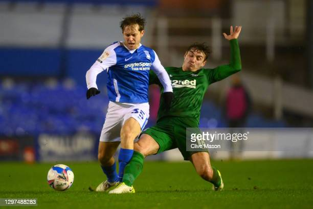 Ryan Ledson of Preston North End tackles Alen Halilovic of Birmingham City during the Sky Bet Championship match between Birmingham City and Preston...