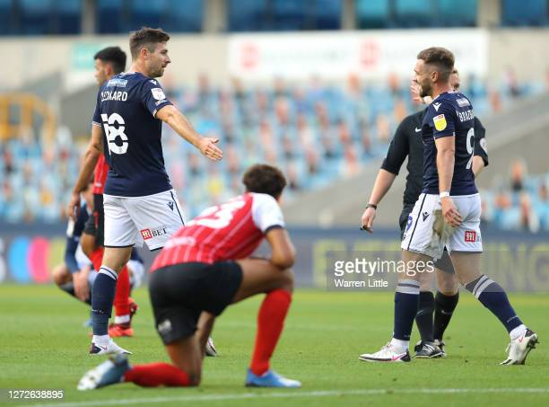 Ryan Leonard of Millwall celebrates with Tom Bradshaw after scoring his team's first goal during the Carabao Cup Second Round match between Milwall...