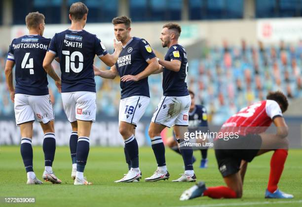 Ryan Leonard of Millwall celebrates with Tom Bradshaw, Shaun Hutchinson and Matt Smith of Millwall after scoring his team's first goal during the...