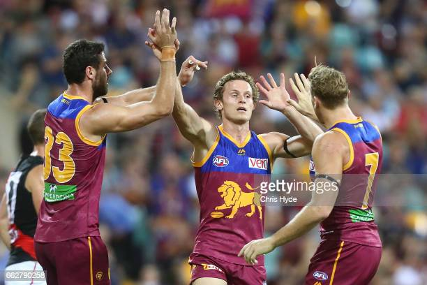Ryan Lester of the Lions celebrates a goal during the round two AFL match between the Brisbane Lions and the Essendon Bombers at The Gabba on April 1...
