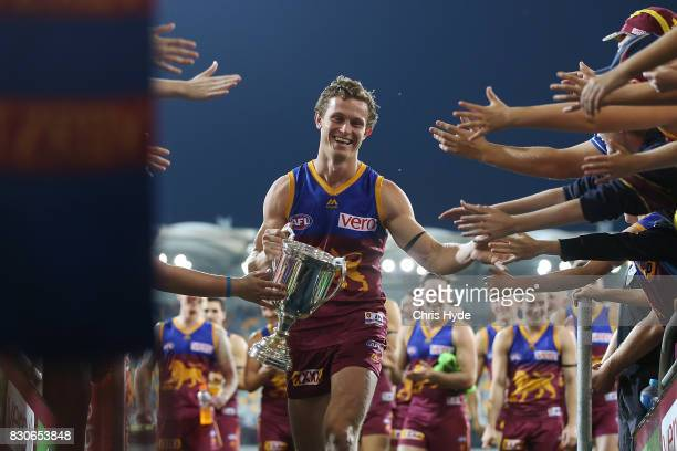 Ryan Lester of the Lions celebrates winning the round 21 AFL match between the Brisbane Lions and the Gold Coast Suns at The Gabba on August 12, 2017...
